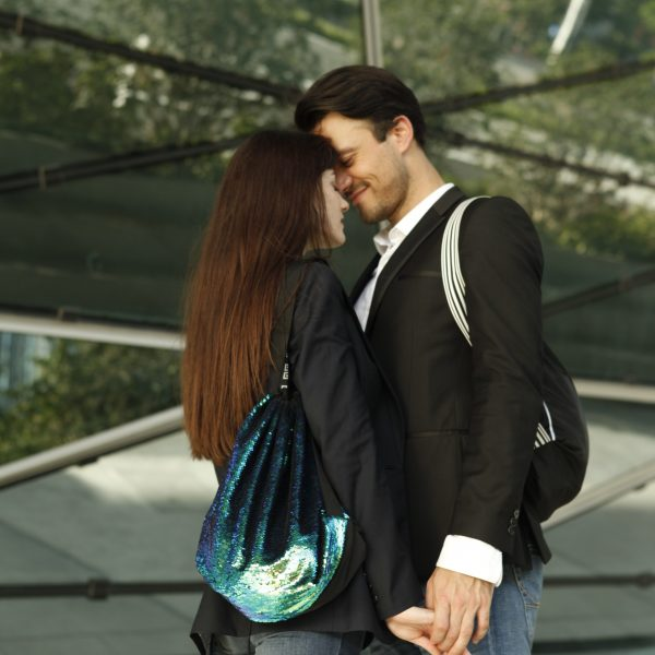 Girl with sequin Auxibag, guy with black Auxibag